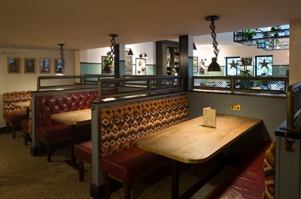 crown & cushion seating at the pub bar