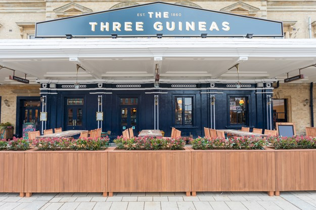 Outdoor seating at The Three Guineas